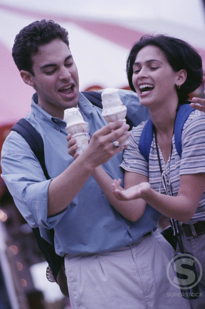 Young couple holding ice cream cones : Stock Photo