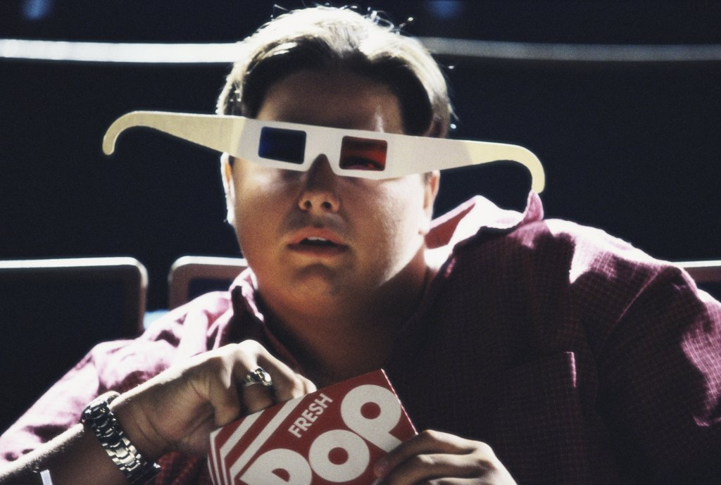 Stock Photo: 1042-10550 Portrait of a teenage boy wearing 3-D glasses in a theater