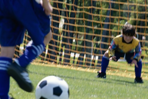 Stock Photo: 1042-1096B Goalie attempting to stop a soccer ball