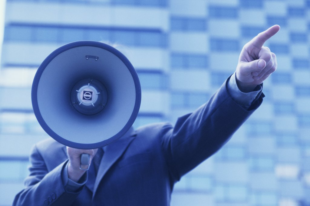 Businessman holding a megaphone : Stock Photo