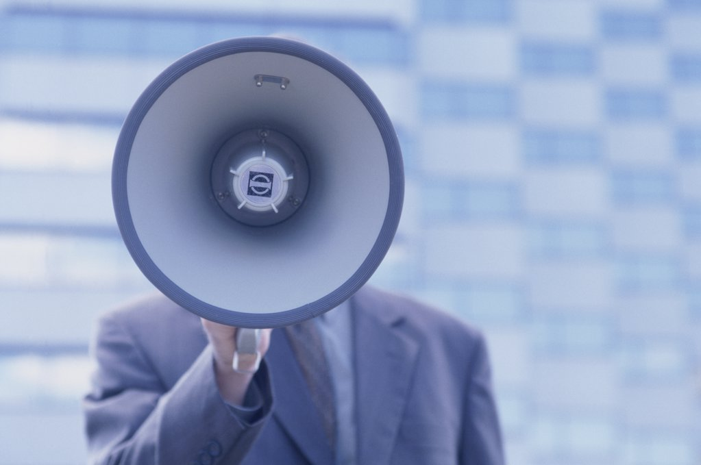 Stock Photo: 1042-11042 Businessman holding a megaphone