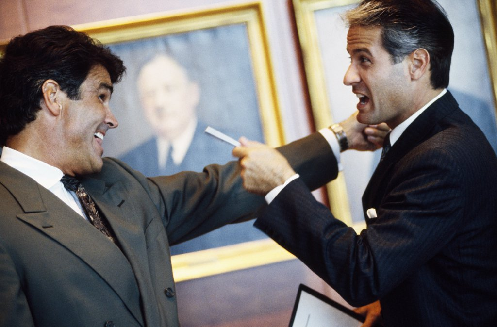 Close-up of two businessmen arguing in an office : Stock Photo