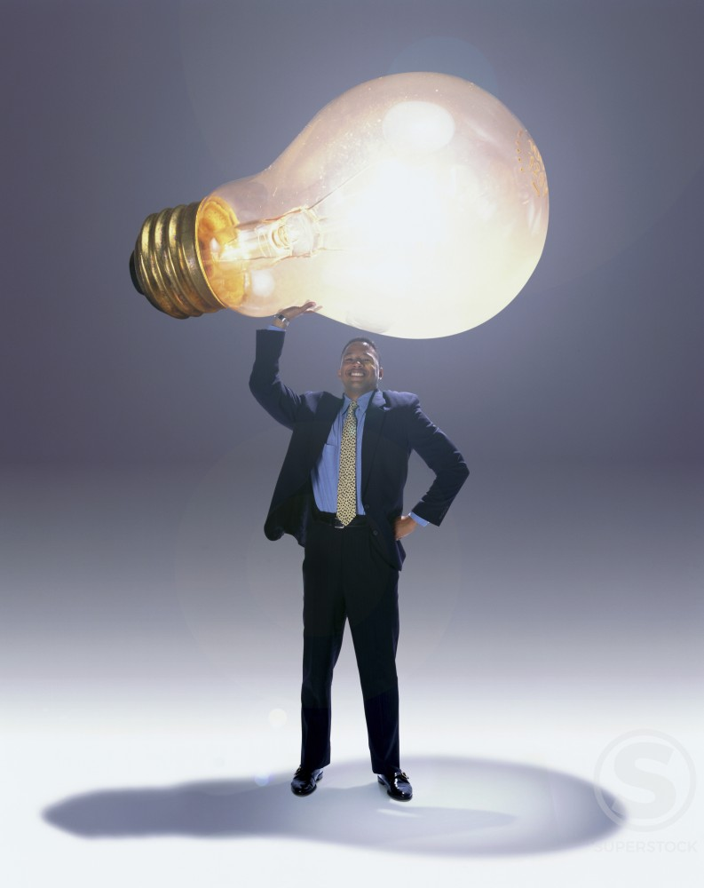 Stock Photo: 1042-2042 Businessman holding a light bulb over his head