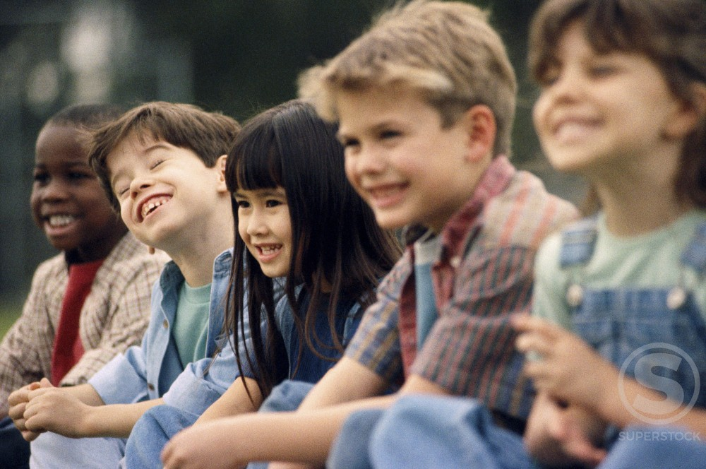 Side profile of a group of children sitting side by side : Stock Photo