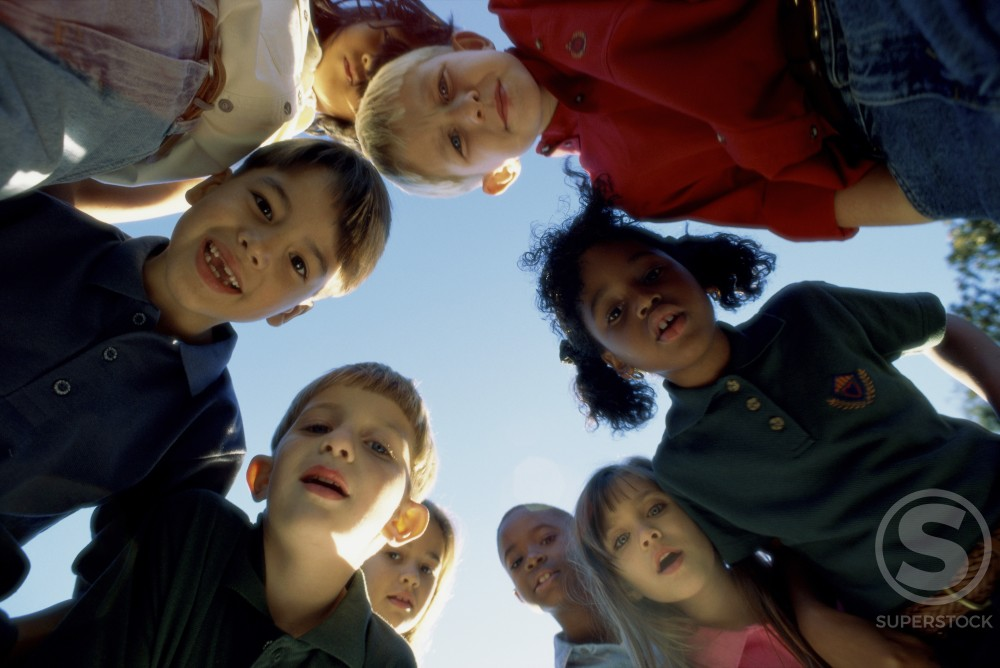 Stock Photo: 1042-283 Portrait of a group of children in a huddle