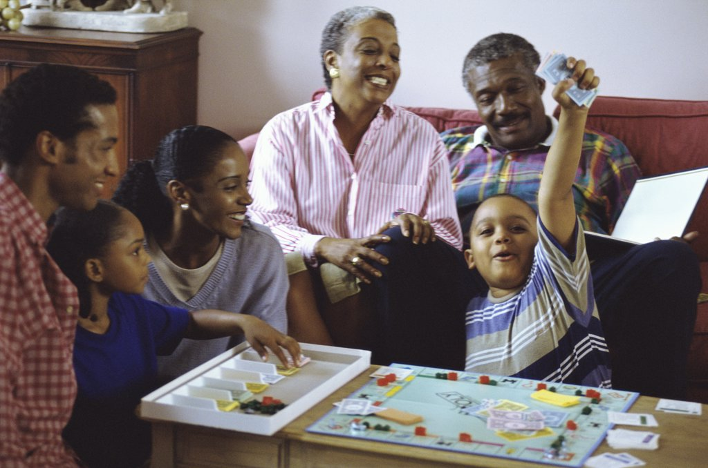 Family playing a board game : Stock Photo