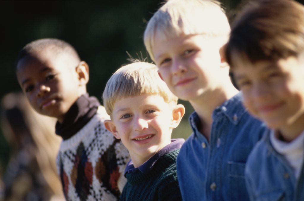 Close-up of a group of boys standing together : Stock Photo