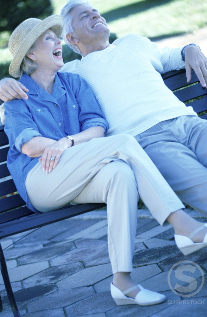 Stock Photo: 1042-3511 Senior couple sitting on a bench