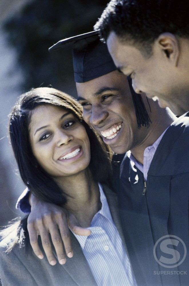 Stock Photo: 1042-3608 Young male graduate standing with his parents