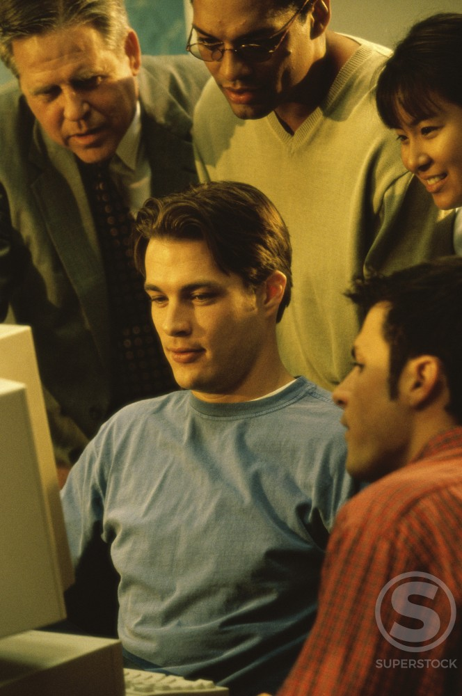 Stock Photo: 1042-3633A Teenage students in front of a computer