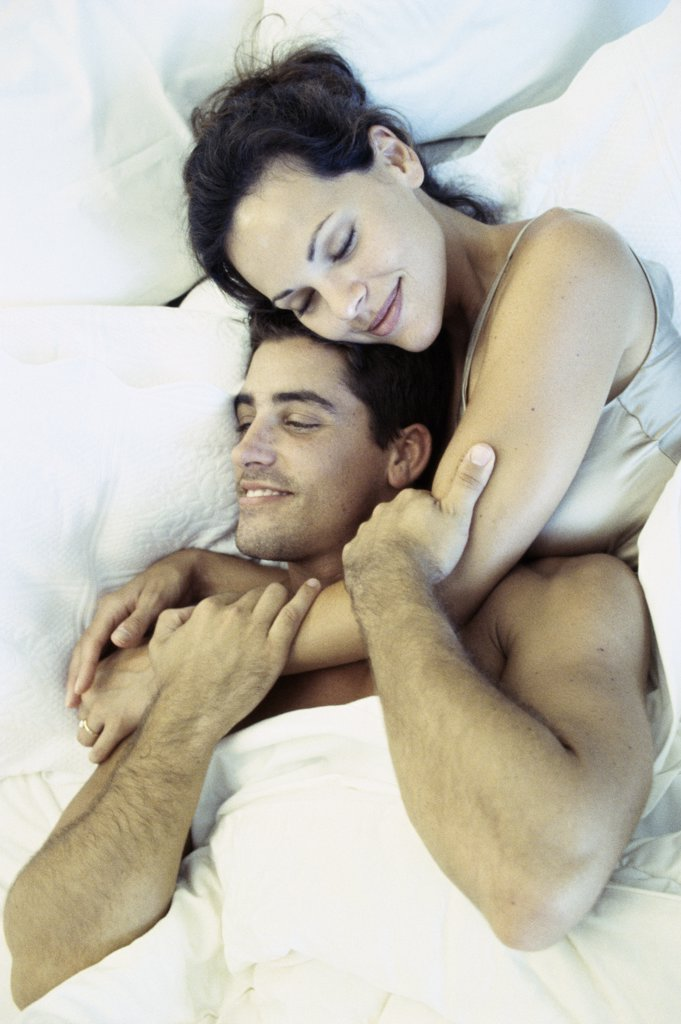 Stock Photo: 1042-4070A High angle view of a young couple lying on a bed