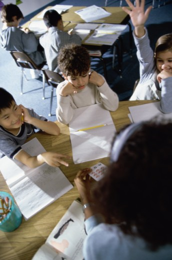 Stock Photo: 1042-4477B Teacher teaching students in a classroom