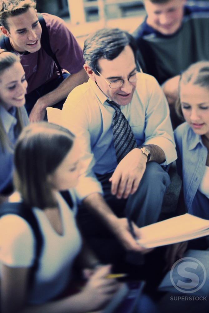 Stock Photo: 1042-4966A Group of teenagers with their teacher