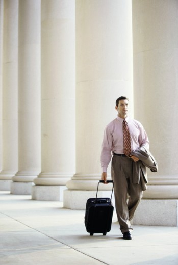 Stock Photo: 1042-5372A Businessman walking with luggage