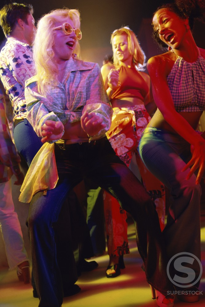 Stock Photo: 1042-5602 Group of teenagers dancing at a nightclub