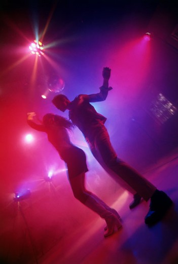 Stock Photo: 1042-5617B Low angle view of a young couple dancing in a nightclub