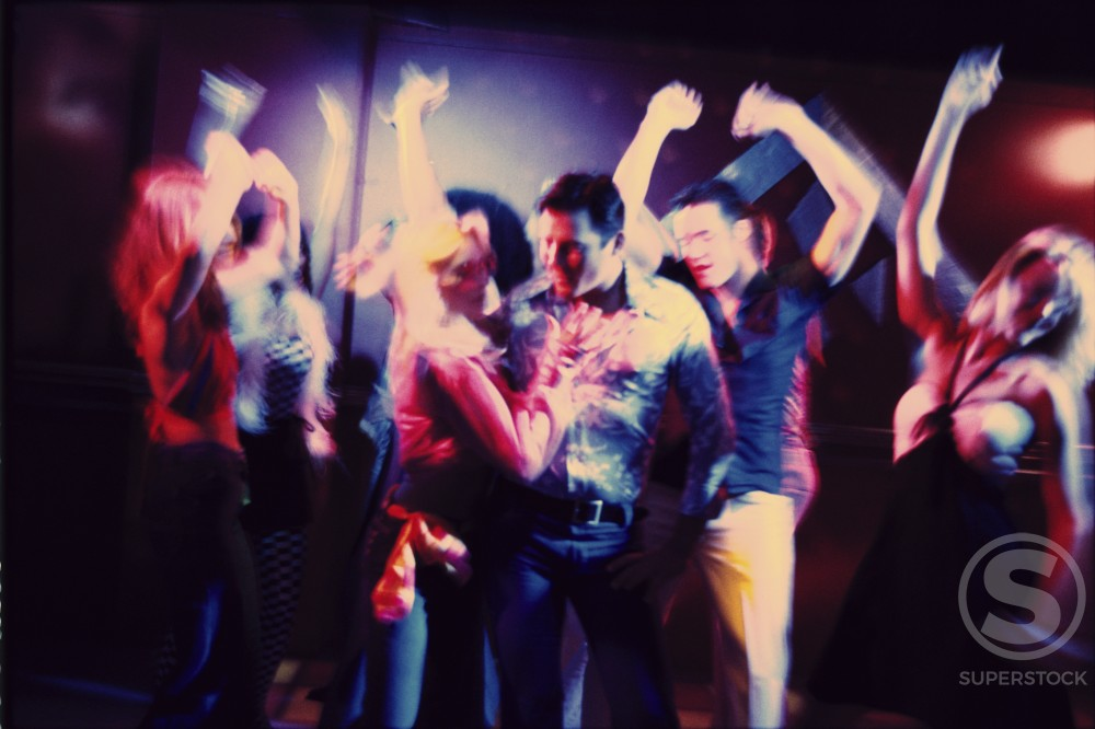 Group of teenagers dancing at a nightclub : Stock Photo