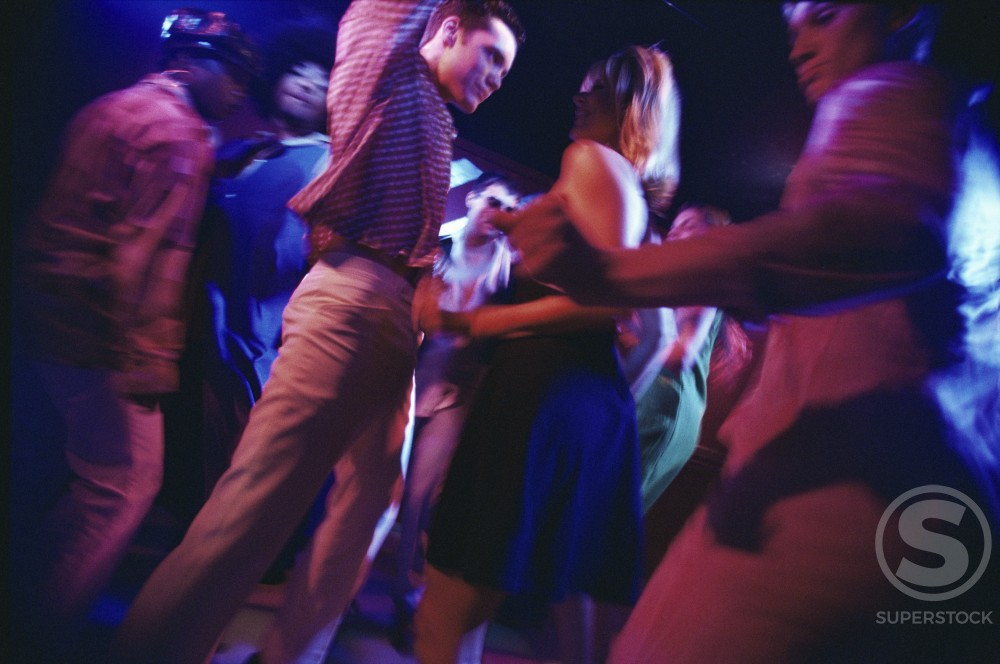 Stock Photo: 1042-5629 Group of teenagers dancing at a nightclub
