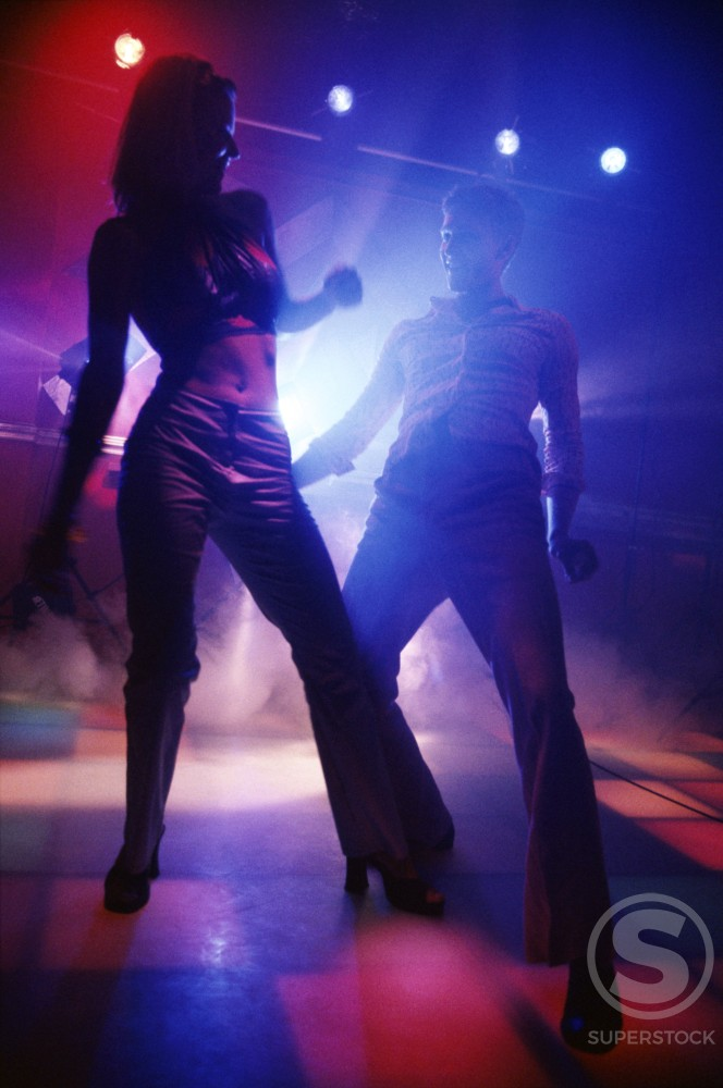 Stock Photo: 1042-5658 Two teenagers dancing at a nightclub
