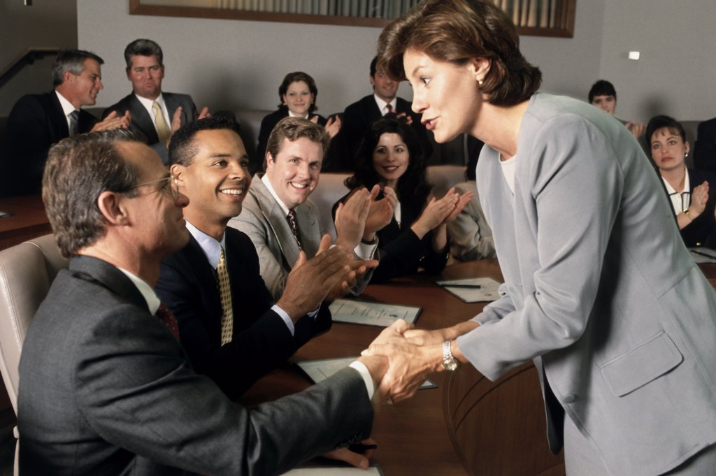 Side profile of a group of business executives in a meeting : Stock Photo