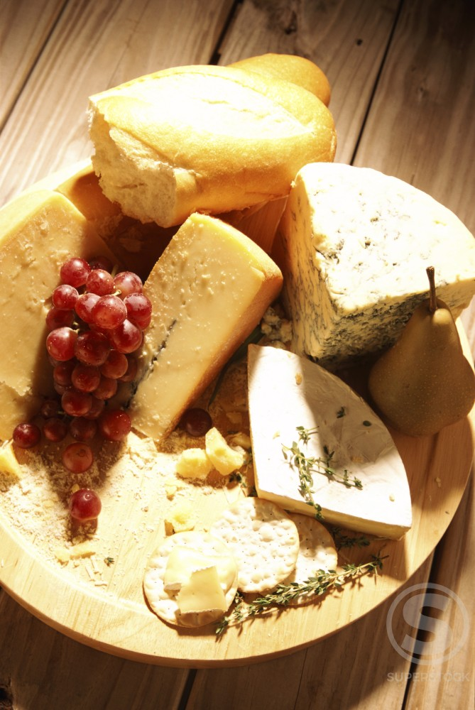 Stock Photo: 1042-8596A Close-up of grapes with assorted cheese