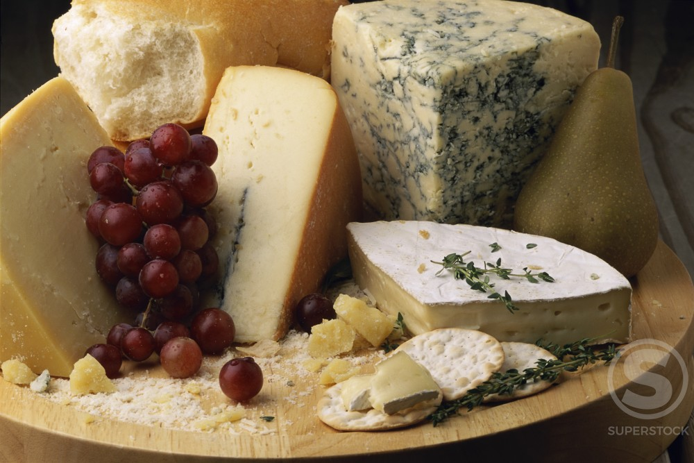 Stock Photo: 1042-8598A Close-up of grapes with assorted cheese