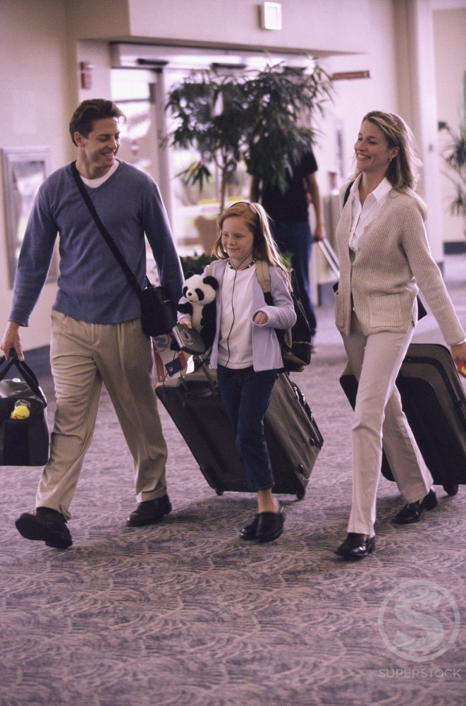 Stock Photo: 1042R-10239 Family walking in an airport