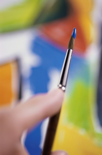Stock Photo: 1042R-10797 Close-up of a person holding a paintbrush