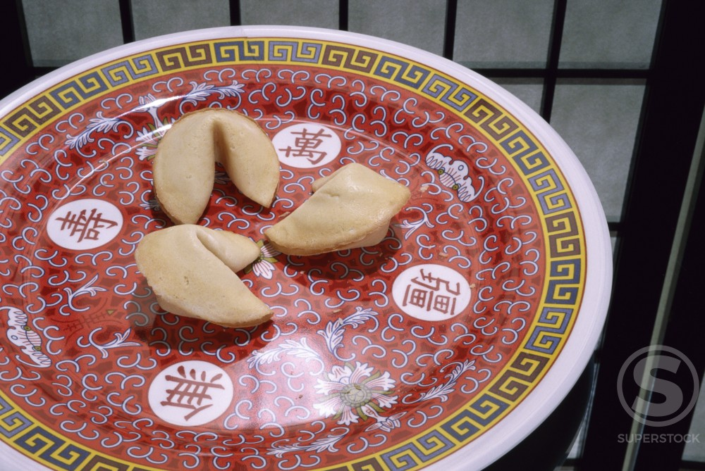 Stock Photo: 1042R-8365 Fortune cookies in a plate
