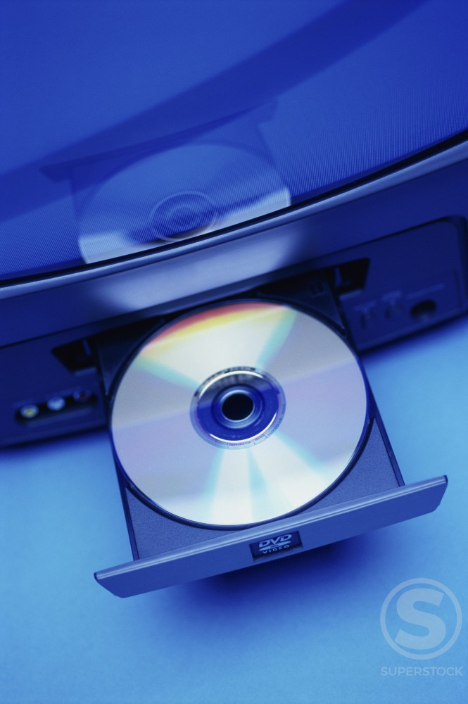 Stock Photo: 1042R-8962 DVD in a player