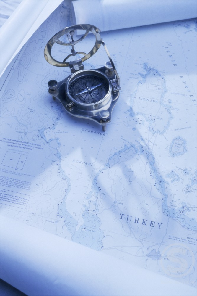 Stock Photo: 1042R-9009 Compass on a map