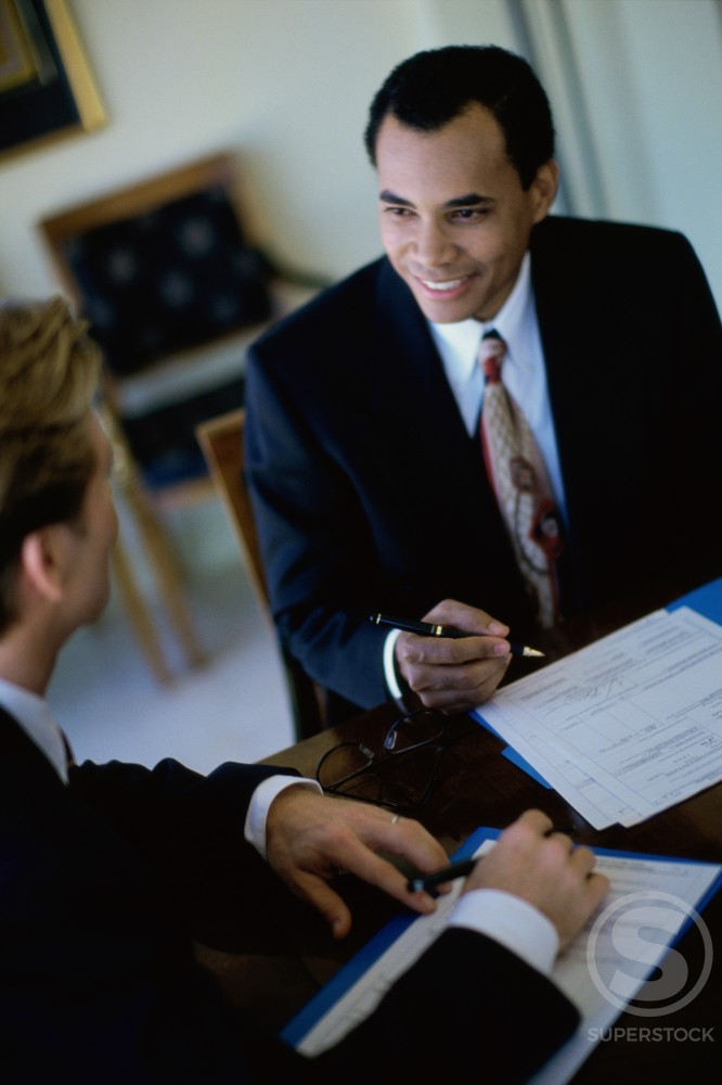 Stock Photo: 1043-205A High angle view of two businessmen talking