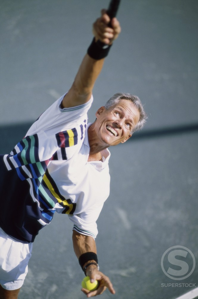 Stock Photo: 1043-425 Senior man playing tennis