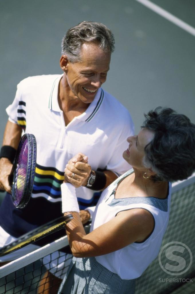 Stock Photo: 1043-428 Senior couple at a tennis court
