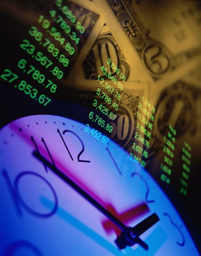 Stock Photo: 1044-105B Close-up of a clock on currency notes