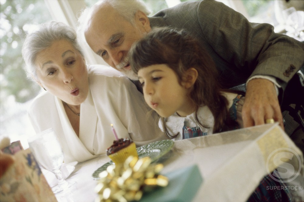 Stock Photo: 1045-119A Granddaughter with her grandparents