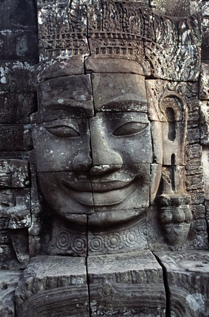 Stock Photo: 105-1945B Details of the face of Avalokiteshvara in a temple, Bayon Temple, Angkor Thom, Cambodia
