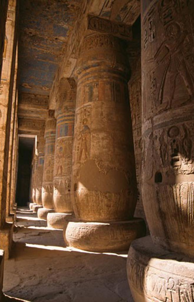 Stock Photo: 105-2563 Low angle view of stone pillars, Great Hypostyle Hall, Temple of Horus, Edfu, Egypt