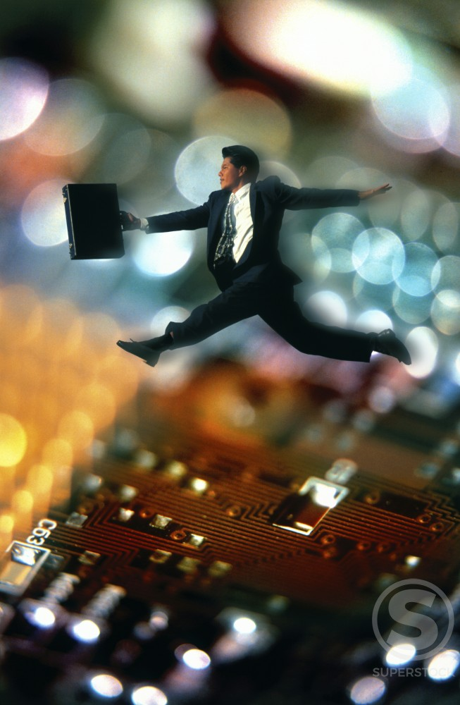 Businessman Inside Computer : Stock Photo