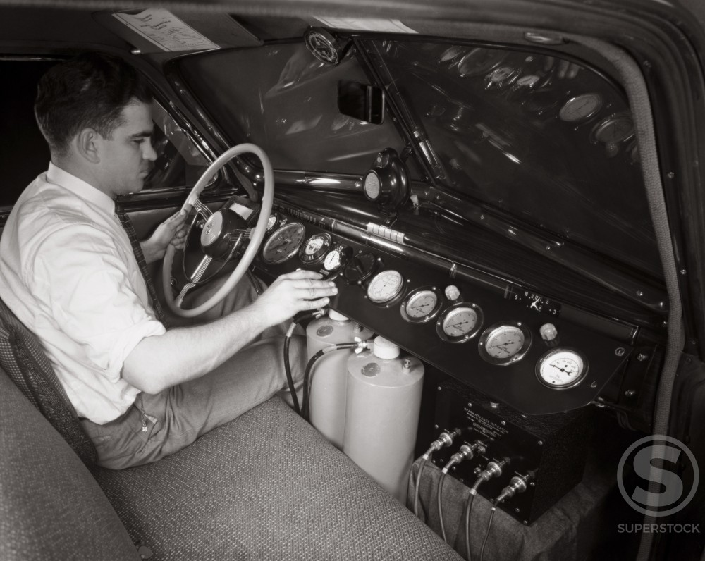 Side profile of a mid adult man testing a car, Cadillac Test Car, 1939 : Stock Photo
