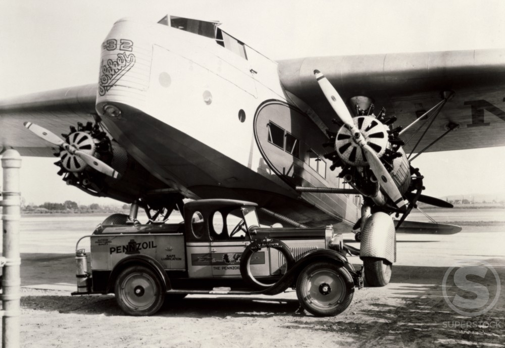 Oil Truck parked near an airplane, Fokker F32, 1930 : Stock Photo