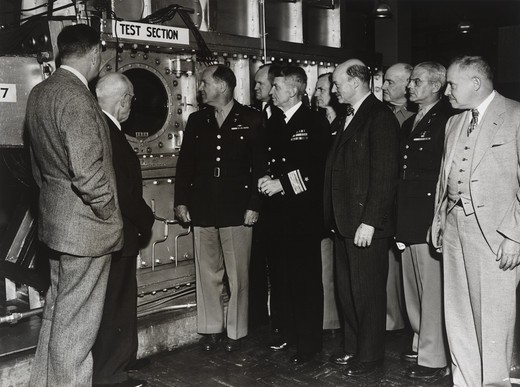 USA, Maryland, Aberdeen, Aberdeen Proving Ground, Ballistic Research Laboratory, Edwin Powell Hubble, Henry Stimson, General Harris, Colonel Eddy, RW Kent and other unidentified men witnessing test at supersonic wind tunnel : Stock Photo