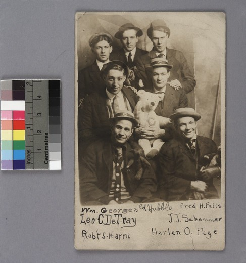 University of Chicago students, Edwin Powell Hubble (back row in center) and William Goergen, Leo C DeTray, Rovert Harris, J Schommer, and Harlan Page. Some men holding stuffed animals, including bear with C on chest : Stock Photo