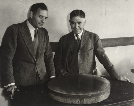 Stock Photo: 1060-2086 Edward Curtis Franklin and Edwin Powell Hubble, viewing fused quartz mirror for telescopes, at opening of session of American Association for Advancement of Science