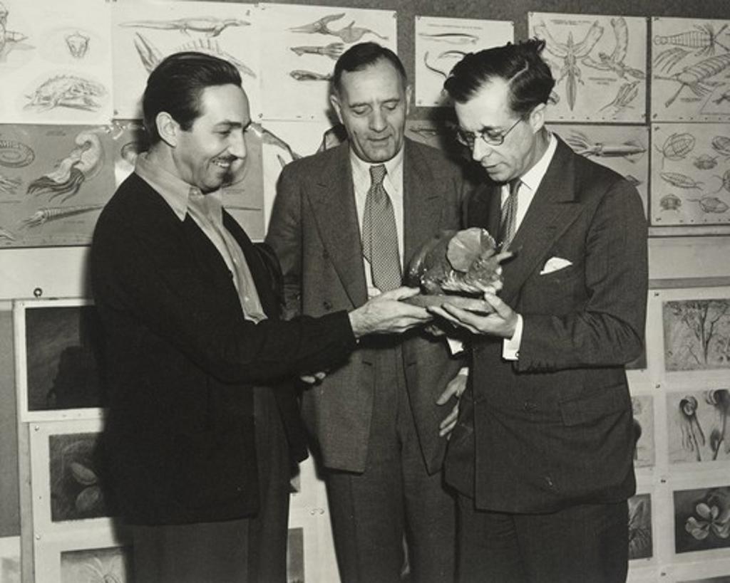Stock Photo: 1060-2124 Walter Elias Disney, Edwin Powell Hubble, and Sir Julian Huxley looking at dinosaur model