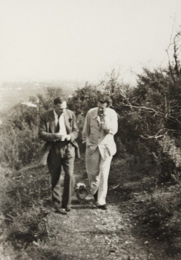 Edwin Powell Hubble and Aldous Huxley walking with Huxley's dog : Stock Photo