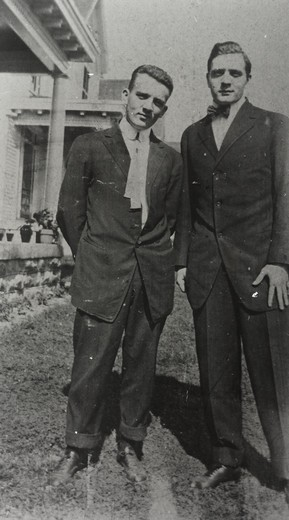 William Hubble (left) and Edwin Powell Hubble standing outside : Stock Photo