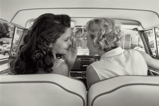 Rear view of two young women talking in car : Stock Photo