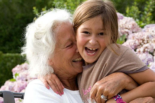 Stock Photo: 1087-3929A Senior woman hugging her granddaughter