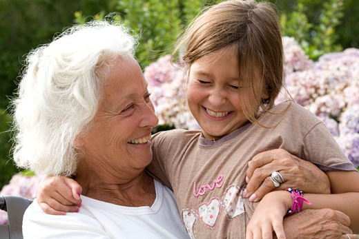 Senior woman hugging her granddaughter : Stock Photo